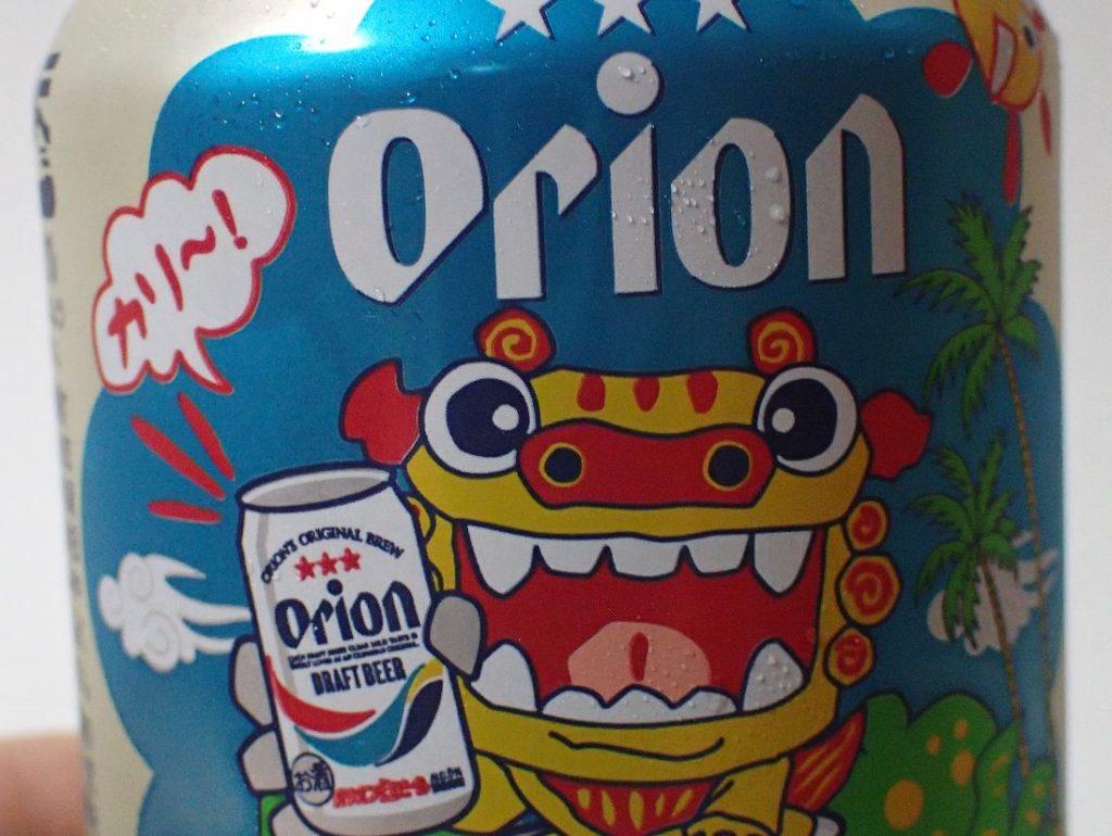 オリオンビールの缶デザイン(カリー!と乾杯するシーサー)