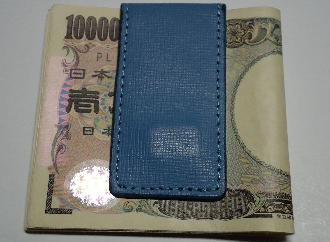 壱万円紙幣・お札をマネークリップで留めた写真
